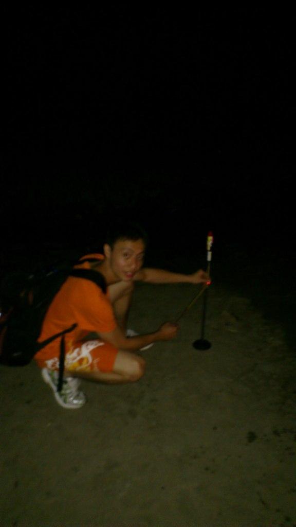 Kenneth lighting up a mini fireworks rocket
